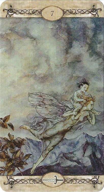 A fairy flies over mountains with a child in this illustration from the Arthur Rackham Tarot